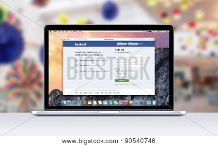 Apple Macbook Pro Retina With An Open Tab In Safari Which Shows Facebook Web Page