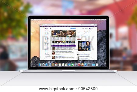 Apple Macbook Pro Retina With An Open Tab In Safari Which Shows Yahoo Web Page