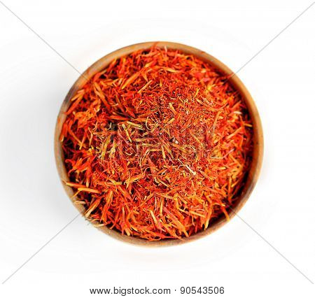 Saffron in wooden bowl, isolated on white
