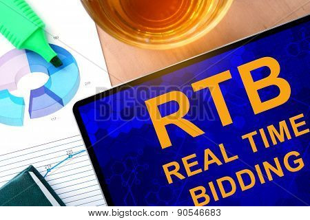 Words Real Time Bidding  RTB on the tablet and charts.