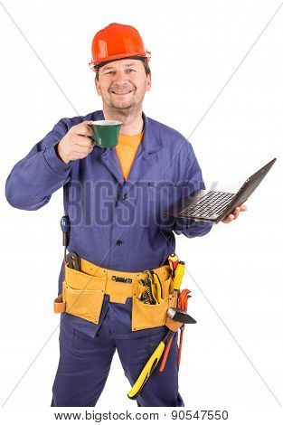 Worker with cup of coffee and laptop.