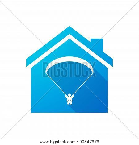Blue House Icon With A Paraglider