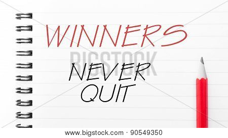 Winners Never Quit  Written On Notebook Page