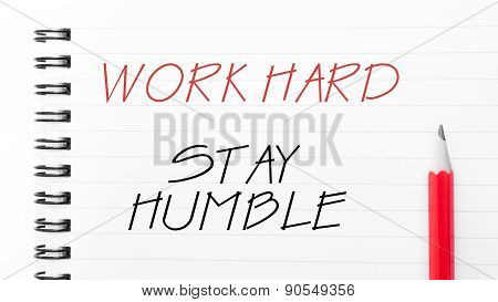 Work Hard Stay Humble  Written On Notebook Page