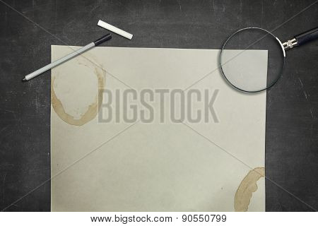 Black blackboard with coffee cup and empty paper sheet