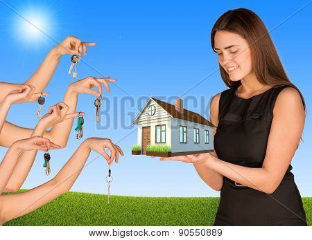 Businesswoman holding house