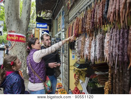 TBILISI, GEORGIA - MAY 07, 2015: Tourists from Russia to buy the Georgian National sweetness