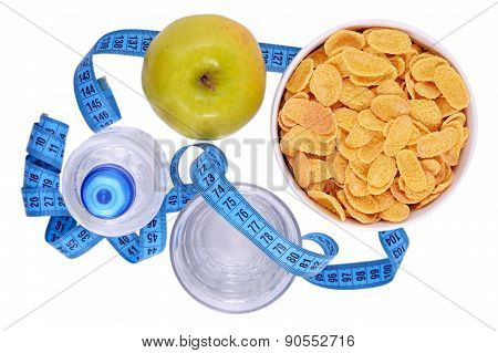 Bottle Of Water, Green Apple, Glass Of Water, Bowl Of Cornflakes And Measuring Tape Isolated On Whit