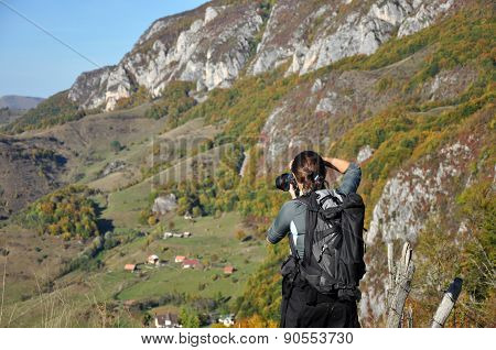 Woman Photographer Taking A Photo In The Mountains