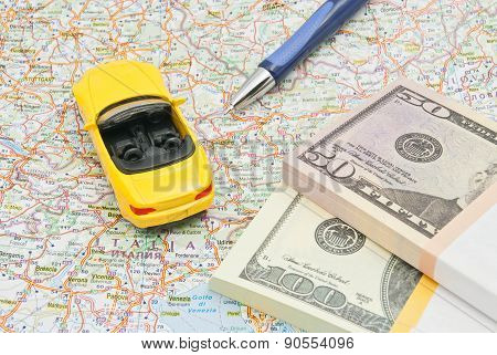 Money, Pen And Yellow Car On Map