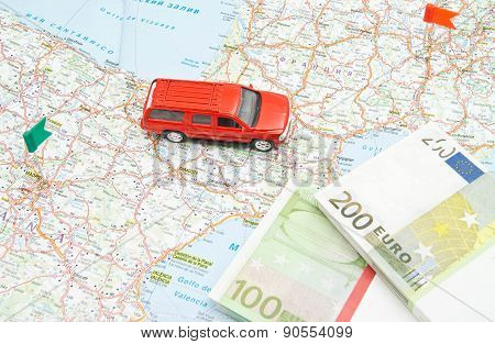 Model Of Red Car And Money On Map