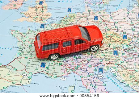Pen And Red Car On Europe Map