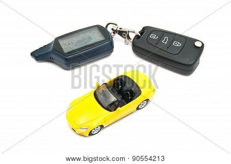 Yellow Car And Keys On White