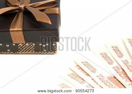 Brown Gift Box And Money Closeup