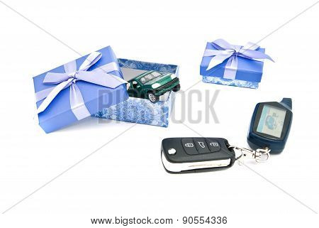 Car Keys, Green Car And Blue Gift Boxes