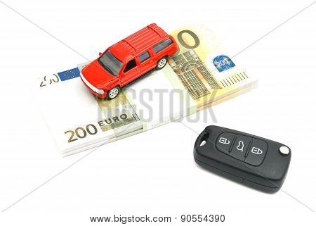 Keys, Red Car And Banknotes