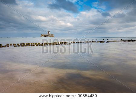 Beautiful View On Baltic Sandy Coast With Old Military Buildings From World War Ii And Wooden Breakw