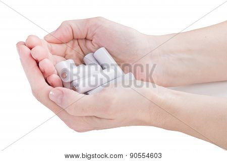 Female Hands Are Kept In An Armful Batteries