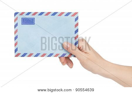 Female Hand Holding Air Mail Envelope