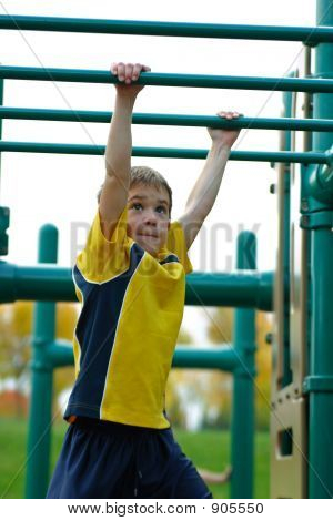 Boy On Monkey Bars