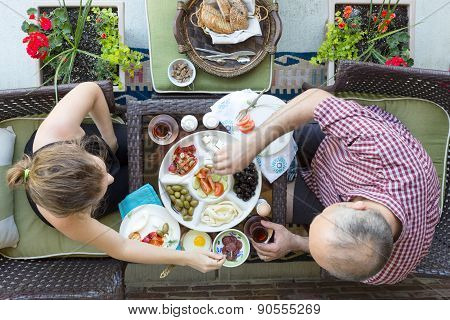 Man And Woman Enjoy An Outdoor Turkish Breakfast
