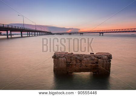 Concrete Bridge Over Sea Water With Sunrise