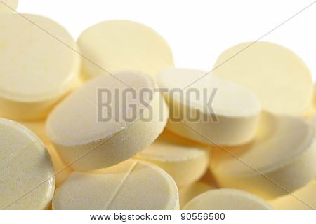 Heap Of Pills On A White