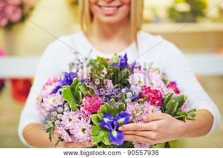 Florist hands with fresh floral bouquet