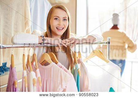 Attractive woman looking at camera in clothing department