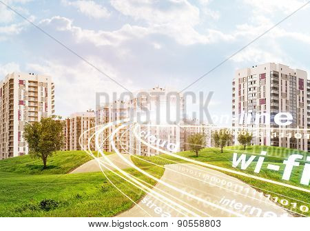 High-rise buildings under cloudy blue sky