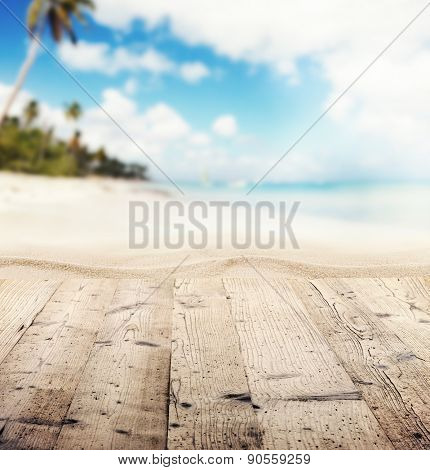 Empty wooden pier with view on sandy beach. Free space for text or product placement