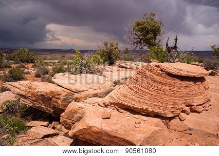 Rain Clouds Gather Over Rock Formations Utah Juniper Trees