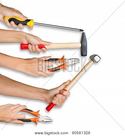 Peoples hands holding tools