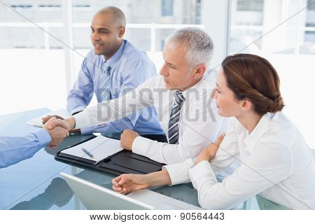 Businessman shaking hand during work interview in the office