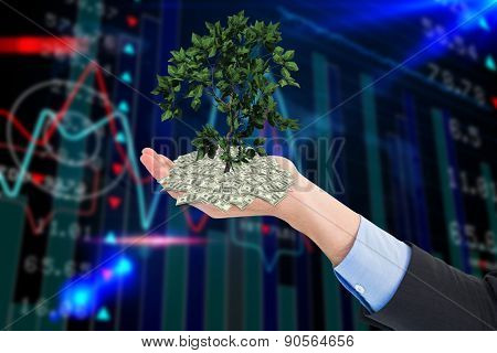 Close up of businessman with empty hand open against stocks and shares