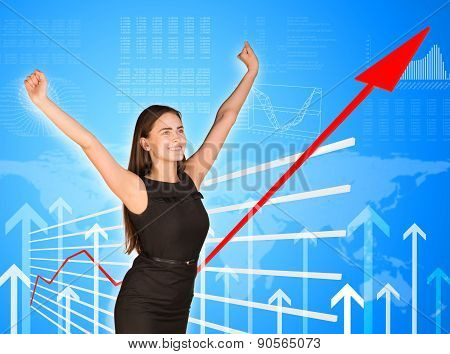 Young businesswoman with arms up
