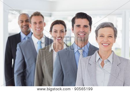 Business people standing in a row in the office