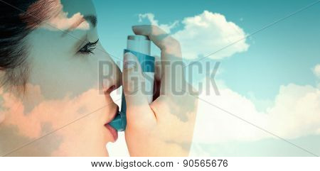 blue sky against woman with an asthma inhaler