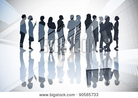 Many business people standing in a line against skyscraper