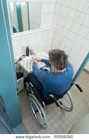 Man On Wheelchair Washing Hands