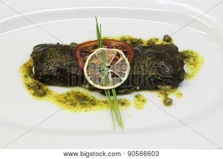 Stuffed flounder grape leaves