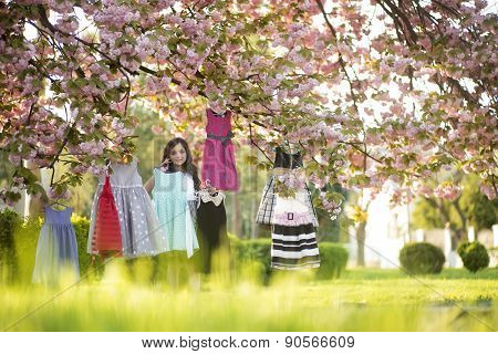 Small Girl Choosing Clothes