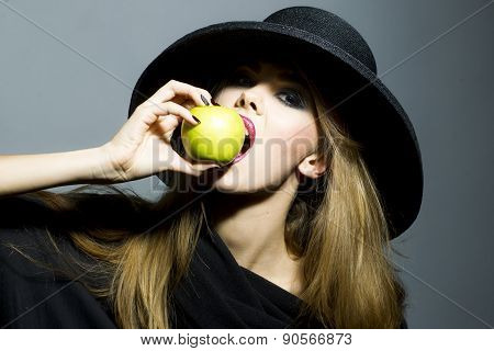 Pretty Blonde Young Woman With Apple