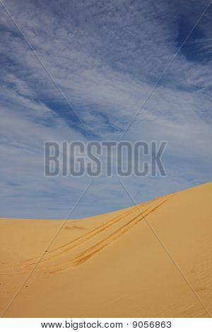 Tyre Tracks On Sand Dune