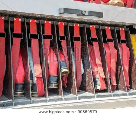 Aprons And Red Pipes In Fire Trucks To Fire Off