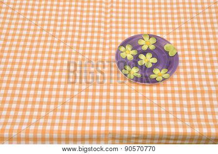 Floral Plate On Yellow Tablecloth