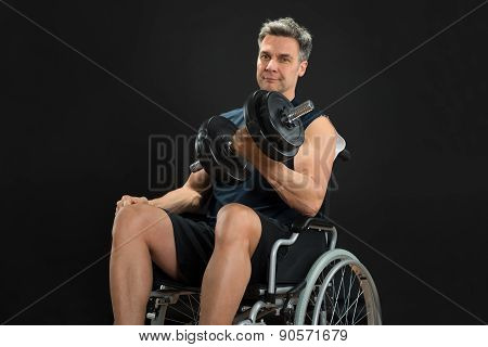 Handicapped Man On Wheelchair Working Out With Dumbbell