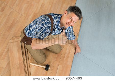 Happy Worker Assembling New Laminate Floor