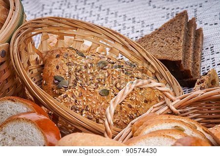 Wicker basket of bread on a tablecloth