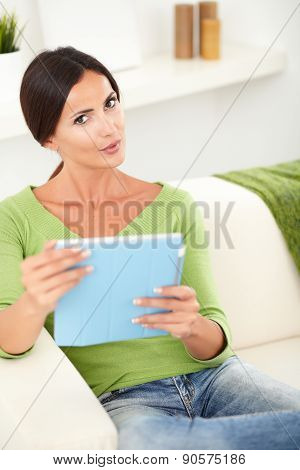 Beautiful Young Woman Holding A Tablet